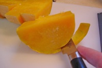Use a paring knife to carve the flesh away from the peel.