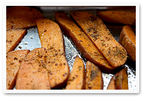 Savory sweet potato fries baking in the oven