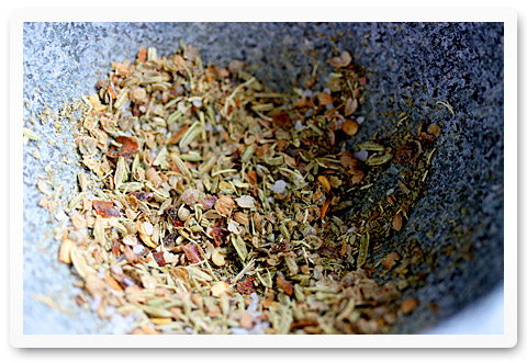 ground spices in the bowl of a mortar